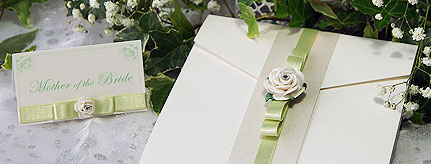 Isabella handcrafted wedding invitation featuring a white paper rose